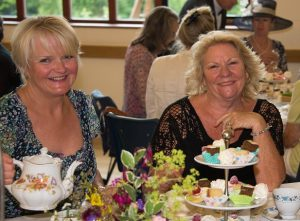 Members enjoying tea