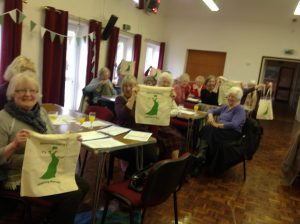 Members displaying their new bags presented at the Birthday Party